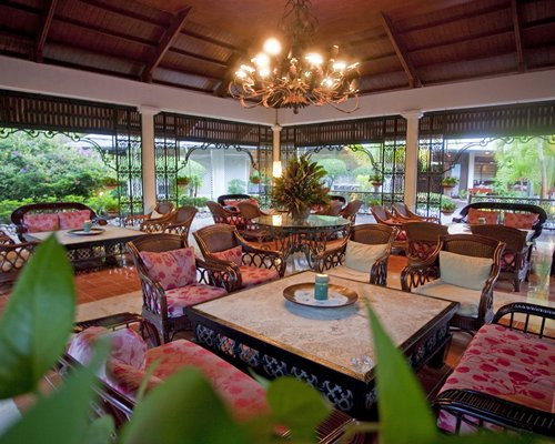 A well furnished indoor lounge area with a patio.