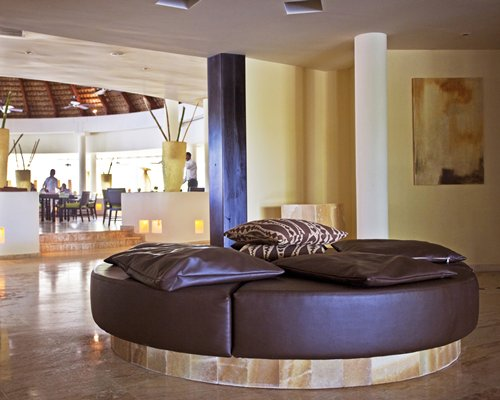 Lounge area and restaurant at Sol Melia Vacation Club.