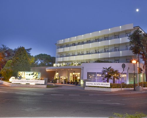 Street view of Hotel Mioni Royal San  Half Board with trees.