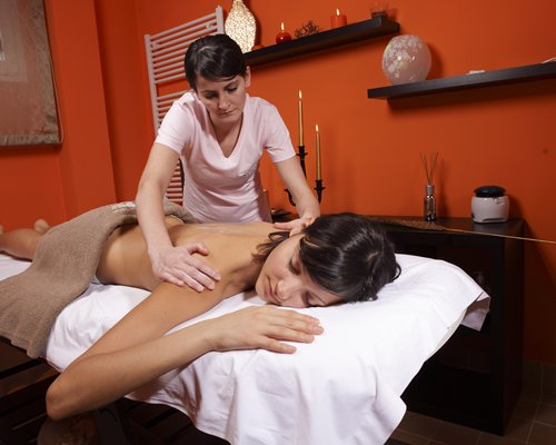 A woman enjoying a massage.