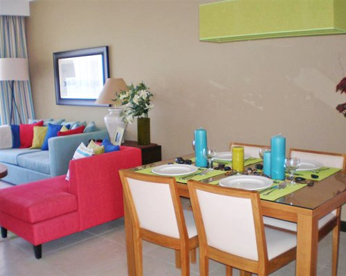 A well furnished living and dining area.
