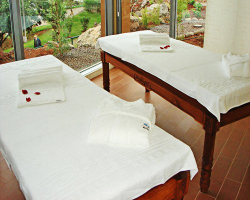 A well furnished indoor spa room with patio.
