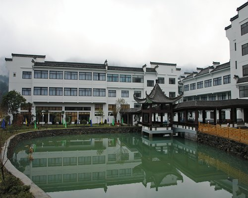 An exterior view of the FVC at Xiangxigu Holiday Village alongside the waterfront.