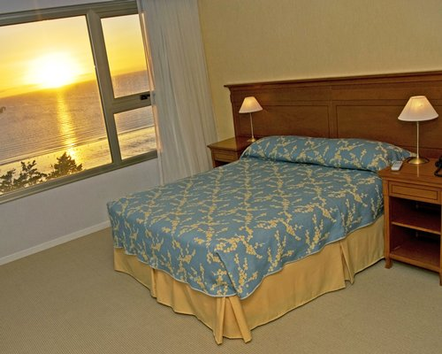 Bedroom with view of sunset.