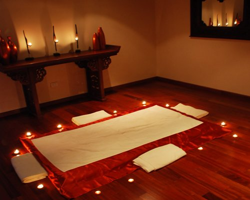 A spa room with candlelight.