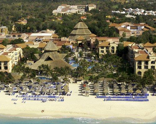 An aerial view of the Sandos Caracol Eco Resort & Spa alongside the beach.