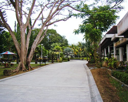 An exterior view of the Club Balai Isabel resort and a road.