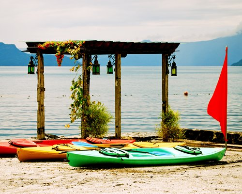 A beachside gazebo with boats.