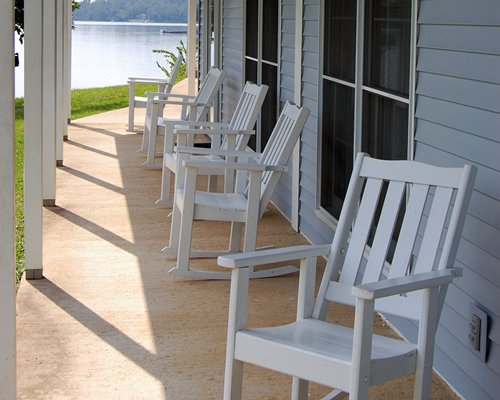 A view of patio furniture in the patio alongside the lake.