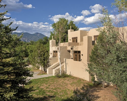 Exterior view of a unit at WorldMark Taos surrounded by wooded area.