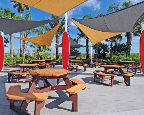 Outdoor dining area with sunshades.