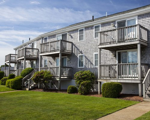 Scenic exterior view of a unit with multiple balconies at Colonial Acres Resort.