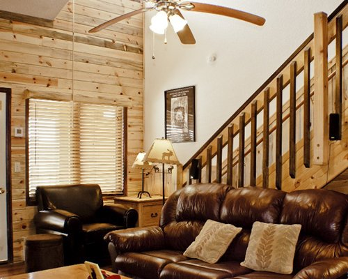 A well furnished living room with a stairway.