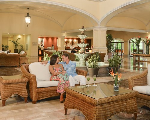 Couple at lounge area with a reception at Hacienda Tres Rios.
