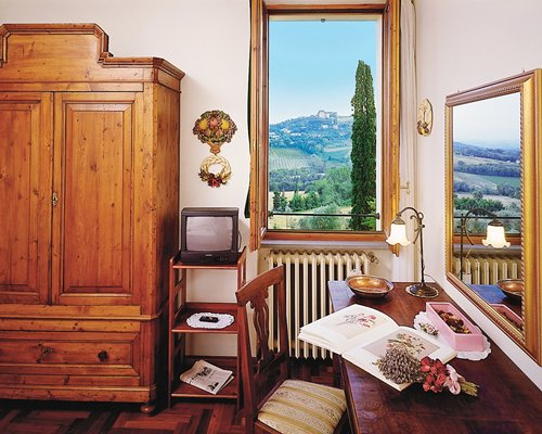 A furnished living area with a television and the mountain view.