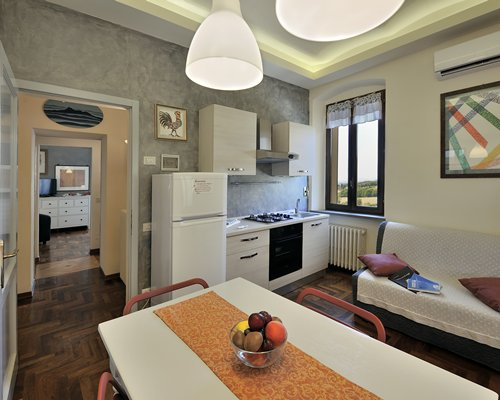 An open plan living dining and kitchen area with an outside view.