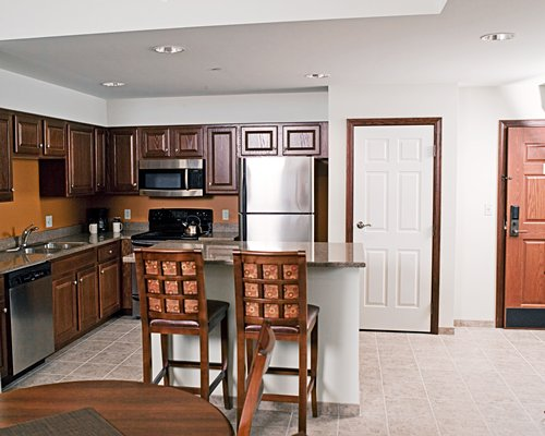 An open plan kitchen with dining area and breakfast bar.