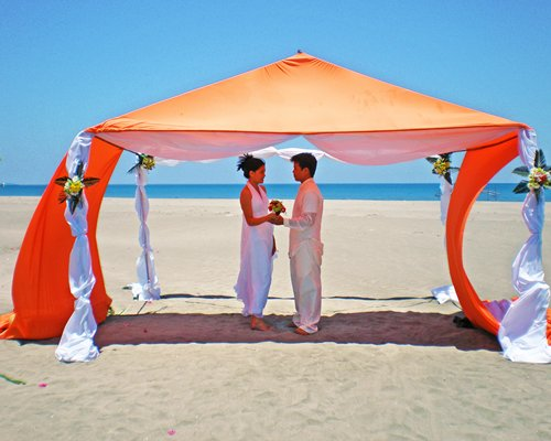 A couple in a beach wedding setup.