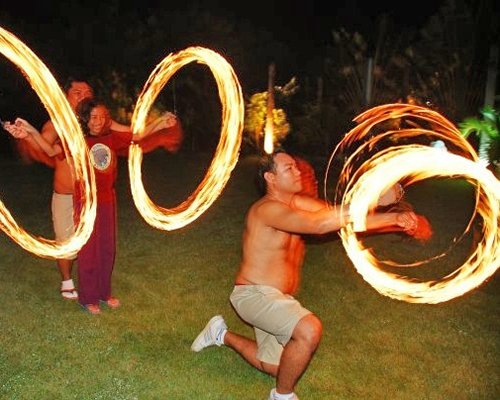 A group of people engaged in a fire performance.