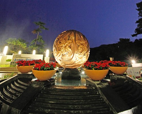 Entrance to The Azalea Baguio Residences with a sculpture.