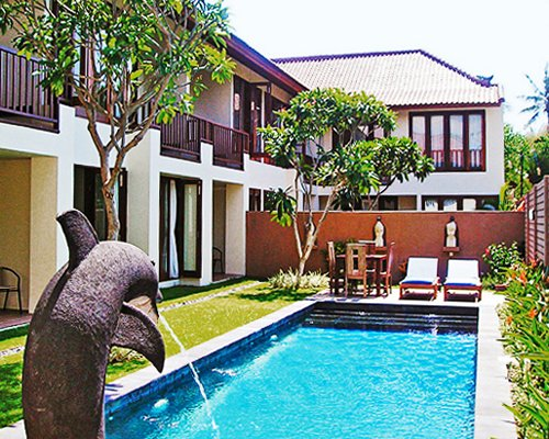 Sekuta Condo Suites with outdoor swimming pool.