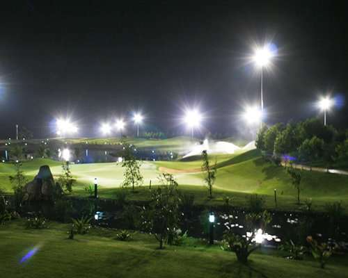 Night view of a well maintained lawn with the waterfront.