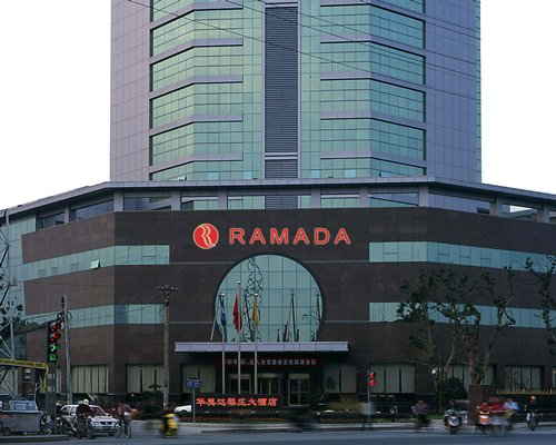 A street view of the multi story Ramada Hotel Wuxi.