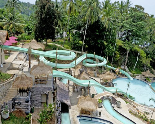 An outdoor swimming pool with water slides.