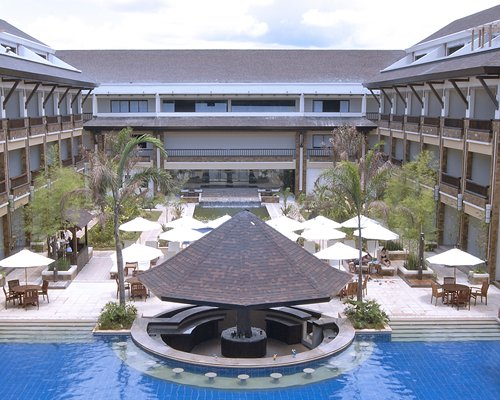 An exterior view of Henann Regency Resort & Spa with the waterfront.
