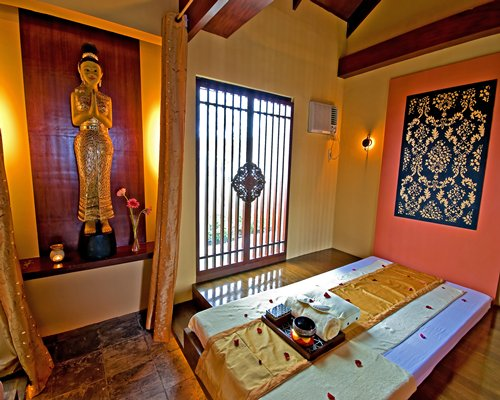 A spa room with an outside view.
