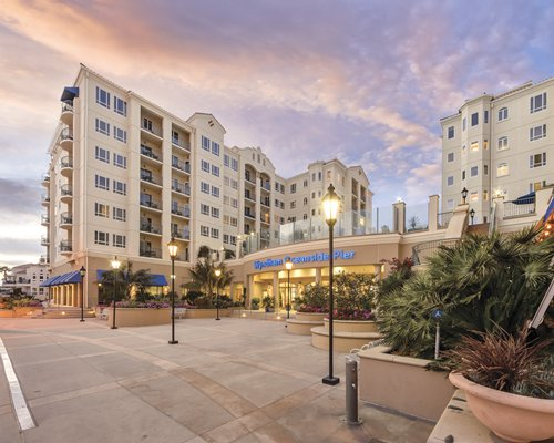 Street view of the Wyndham Oceanside Pier Resort at dusk.