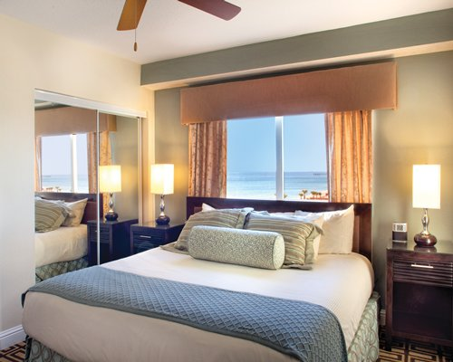 A well furnished bedroom with the beach view.