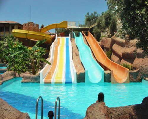 Outdoor swimming pool with water slides.