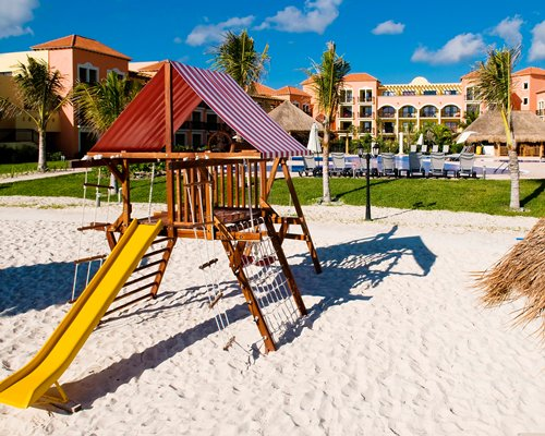 Outdoor playscape at Ocean Coral & Turquesa.