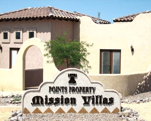 Signboard and entrance view of The Mission Villas at Silver Lakes.