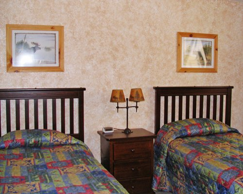 A well furnished bedroom with two twin beds.