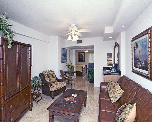 A well furnished living room alongside bedroom.