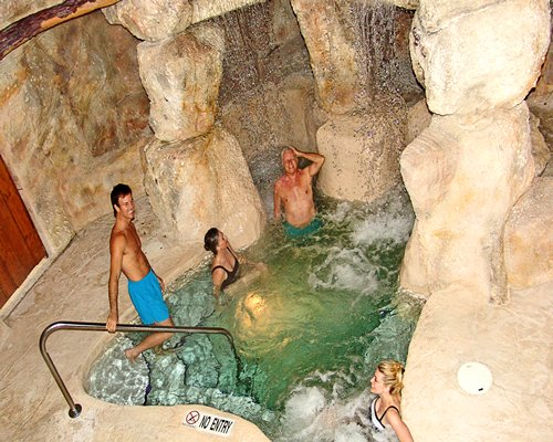 View of people inside the indoor hot tub.