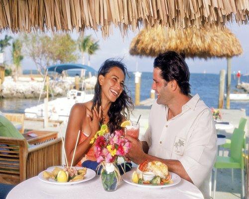 A couple enjoying in an outdoor fine dining restaurant.