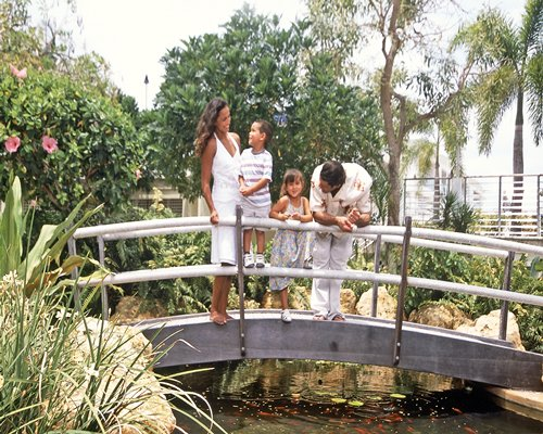 A family standing on the bridge.
