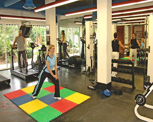 View of people exercising at the well equipped fitness center.
