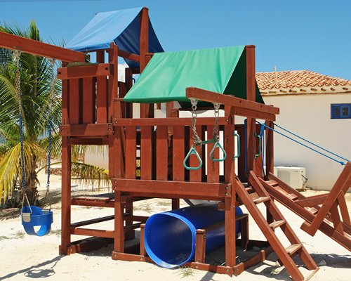 An outdoor kids play area alongside resort unit.