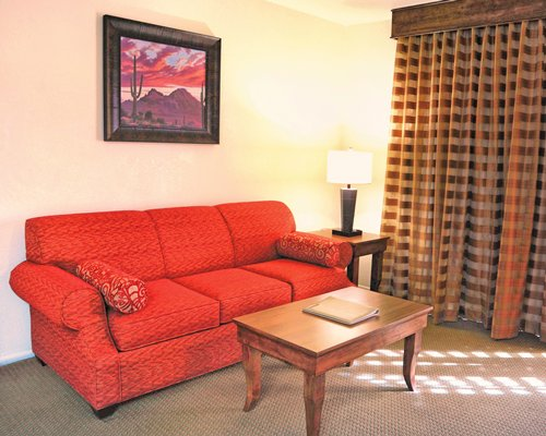A well furnished living room with pull out sofa.