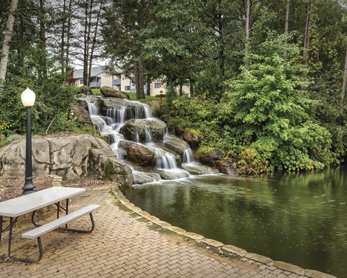 A view of picnic table alongside the waterfall.