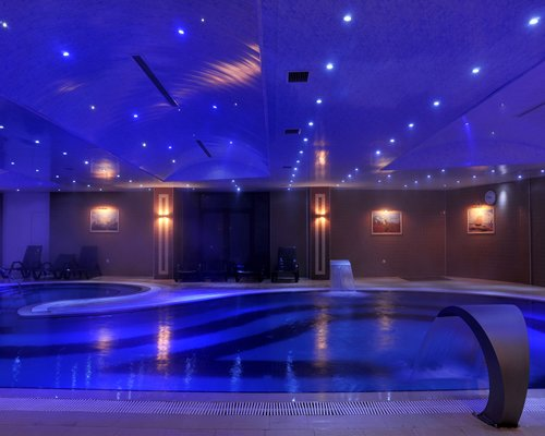 An indoor swimming pool with neon lights.