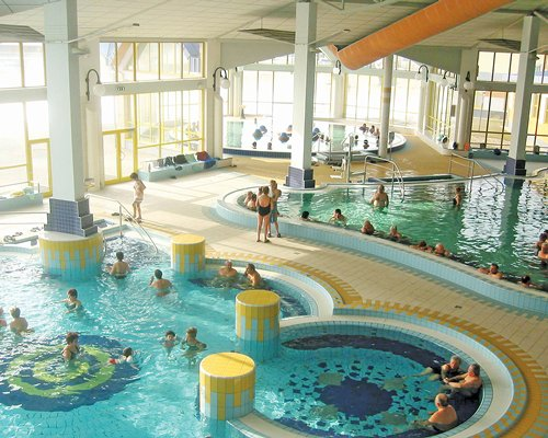 View of indoor swimming pools with an outside view.