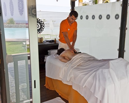 A man having a body massage at the spa.