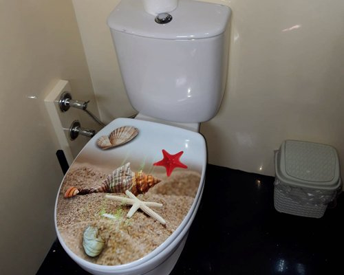 Interiors of a yacht with living area and a sink.