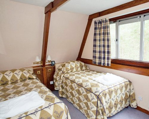 A well furnished bedroom with two beds.