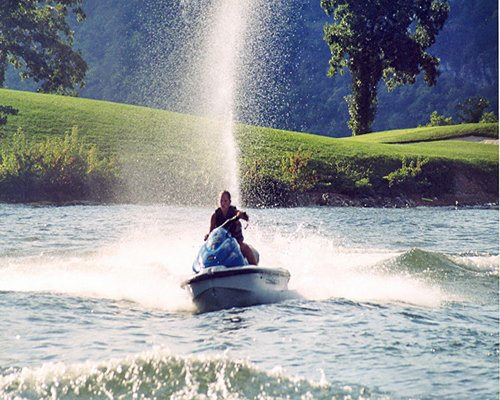 A man riding a jetski at the lake.